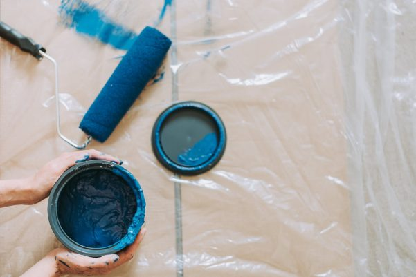 Roller painting with blue paint